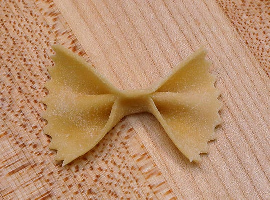 Farfalle means butterflies; the pasta shape is known as bow ties in the U.S.