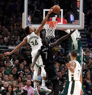 Bucks forward Giannis Antetokounmpo rejects a shot from the Pistons' Thon Maker during Game 2.