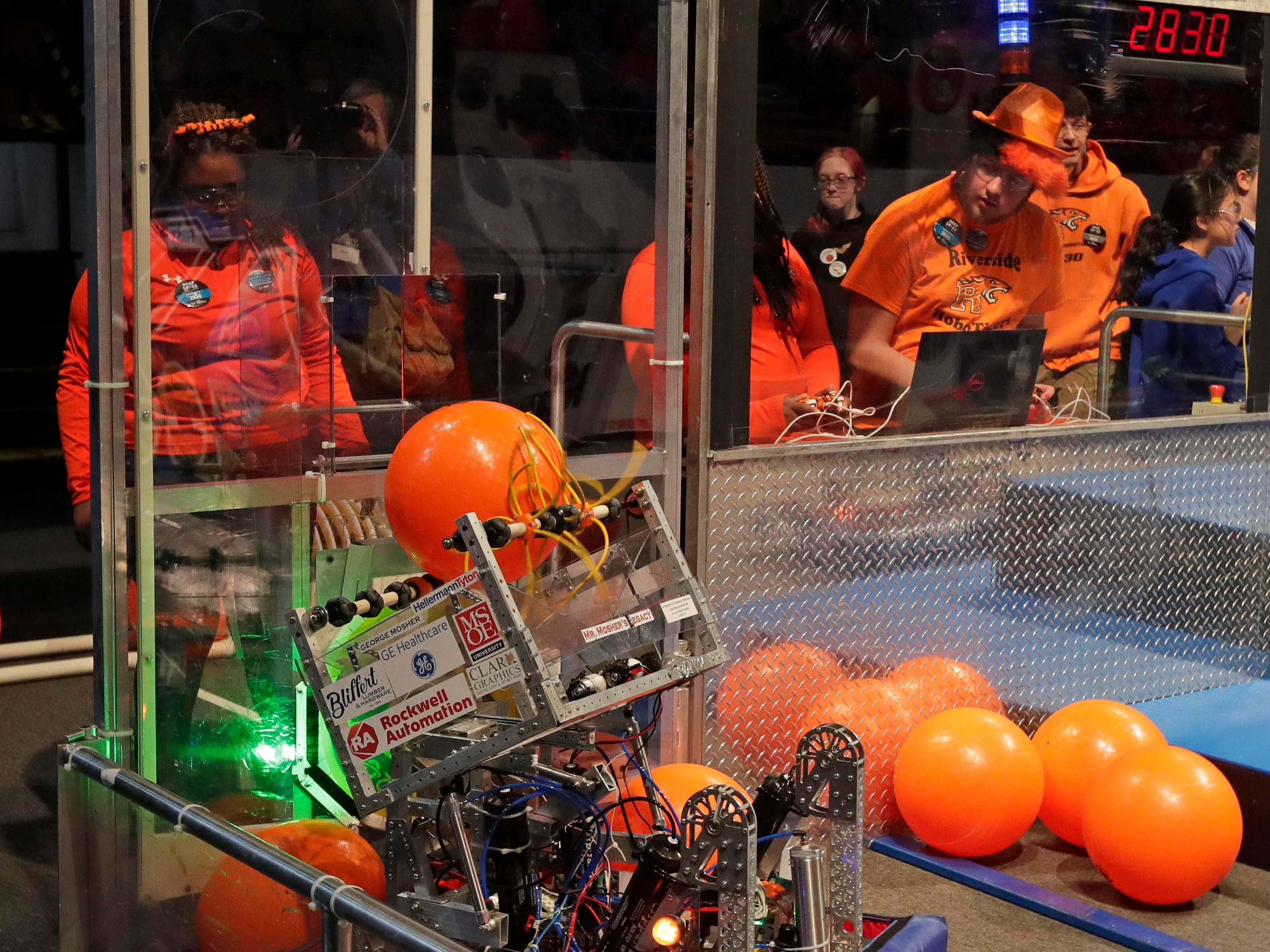 Operators Mikalayah Tulloch, Arianna Massey, Damien Berna and Mordechai Tinney  guide their 2830 robot during competition.