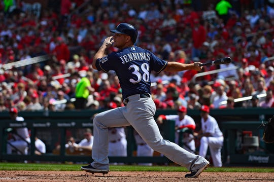 Dan Jennings of the Milwaukee Brewers hits a double during the seventh inning against the St. Louis Cardinals at Busch Stadium on April 11, 2018 in St Louis, Missouri.
