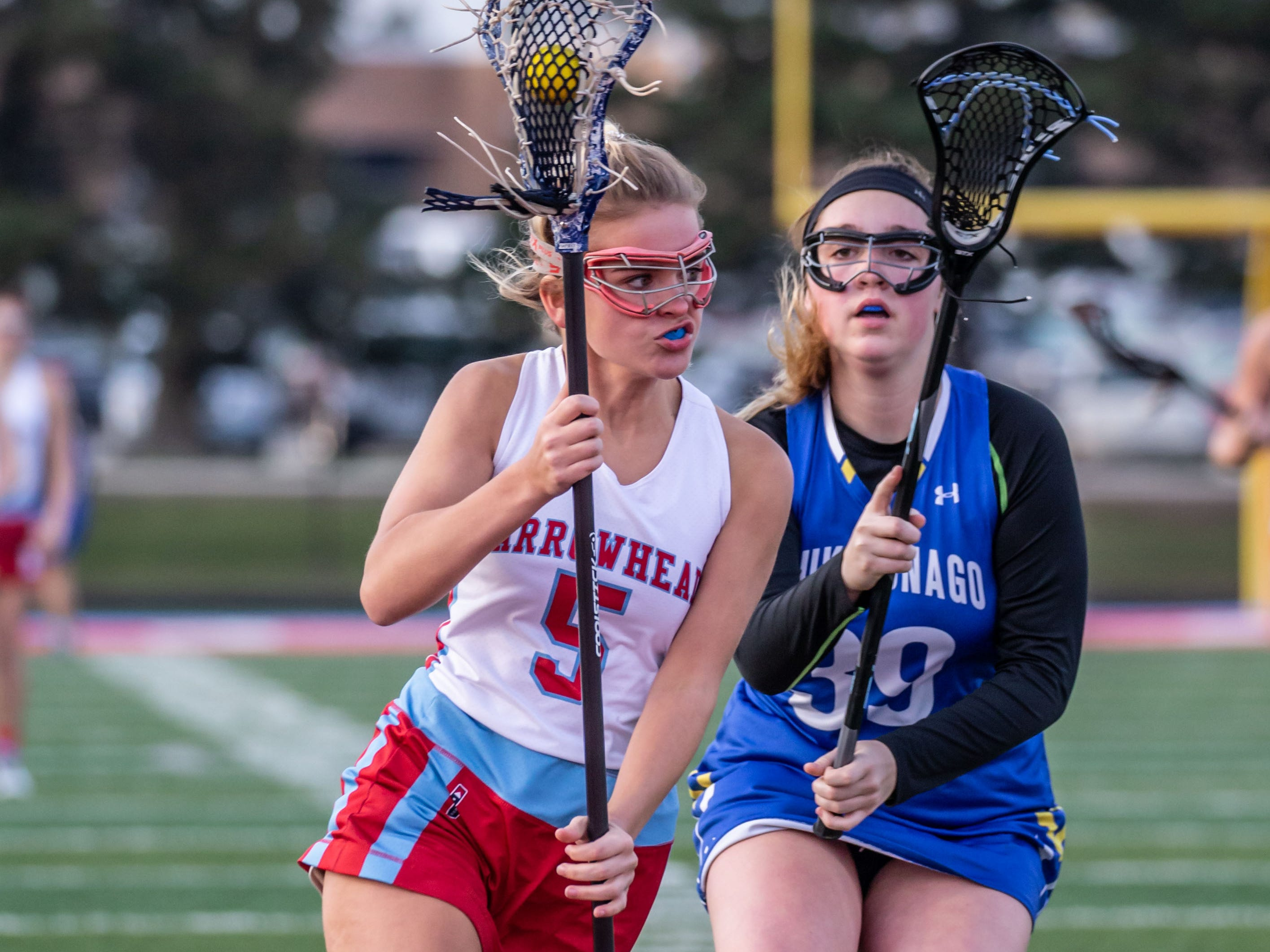 Arrowhead's Hunter Phillips (5) looks to get past Mukwonago's Hannah Cayon (39) during the game at Arrowhead on Tuesday, April 16, 2019.