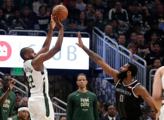 Bucks forward Khris Middleton launches and cans a three-pointer over Pistons center Andre Drummond during the first half Wednesday night. He quietly finished with 24 points and eight assists in 33 minutes.