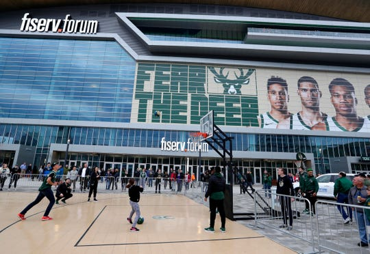 Fans shoot hoops outside the Fiserv Forum before Game 2.