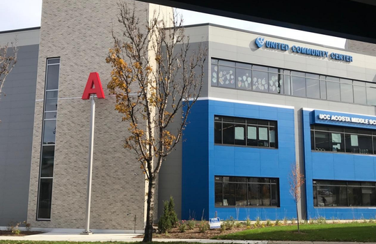Letters on posts represent aspects of Milwaukee's water. The A at Acosta Middle School could stand for Acosta, aquatic awareness andagua, the Spanish word for water.