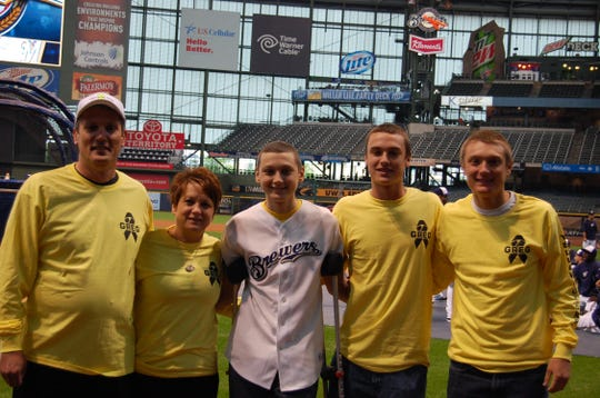 The Von Ruedens (from left, Denny, Sharon, Greg, Jake and Bob) pose at a Brewers game. Greg died after a battle with bone cancer in 2014.