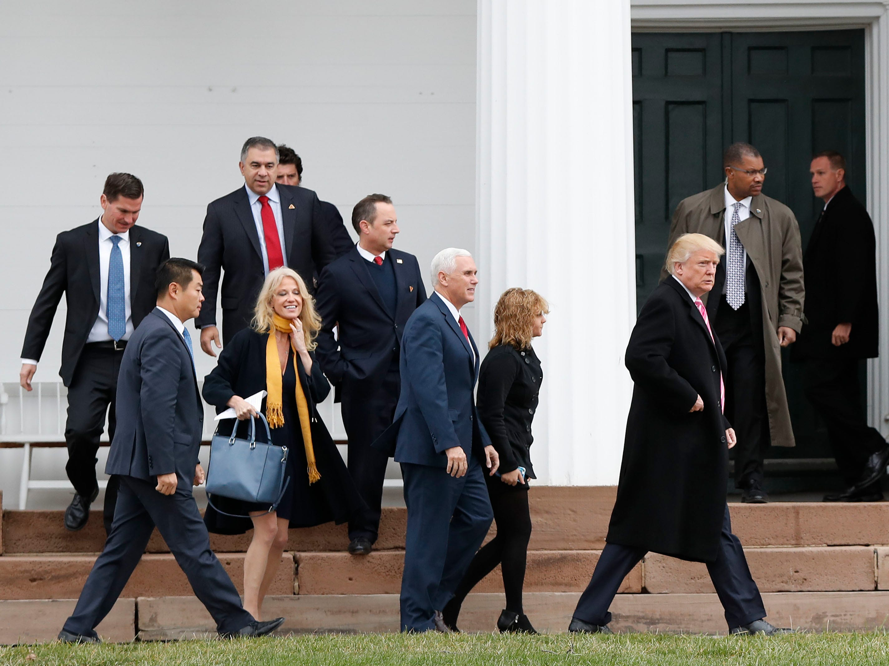President-elect Donald Trump (foreground from right), Charlotte Pence, Vice President-elect Mike Pence, incoming White House Chief of Staff Reince Priebus and Kellyanne Conway leave services at Lamington Presbyterian Church in Bedminster, N.J.