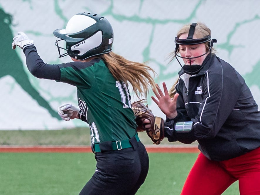 DSHA second baseman Michelle Dooge tags Wauwatosa West's Sophie Stuppy (11) but drops the ball during the game at Tosa on Wednesday, April 17, 2019.