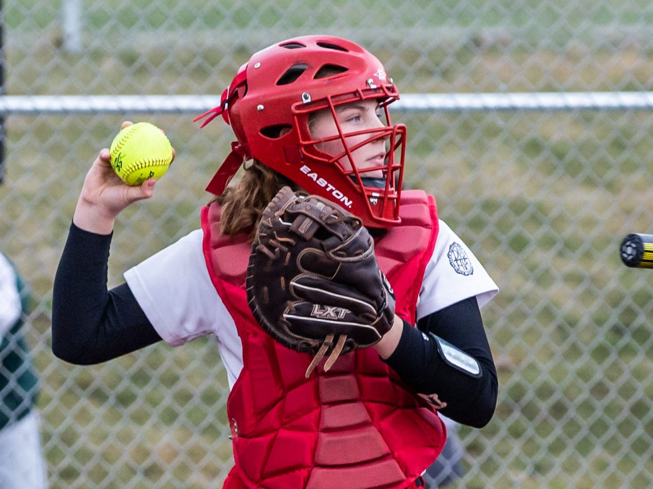 DSHA catcher Brooke Mackey holds back a runner on second during the game at Wauwatosa West on Wednesday, April 17, 2019.