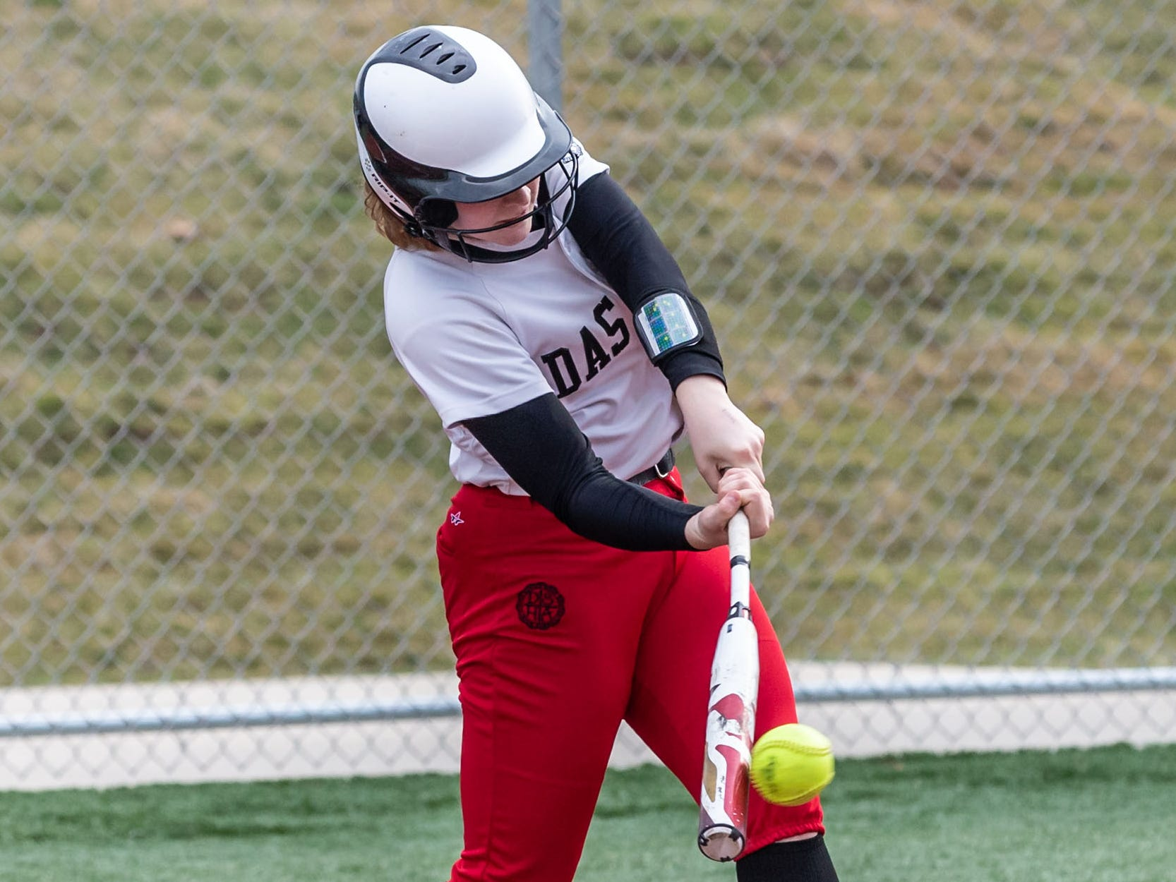 DSHA's Brooke Mackey connects for a single during the game at Wauwatosa West on Wednesday, April 17, 2019.