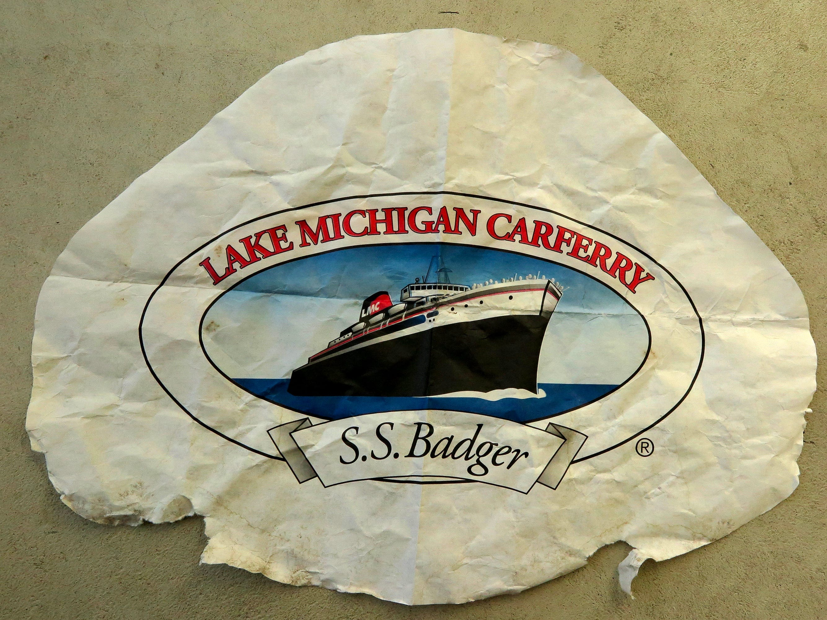 This the front side of a placemat used to write a message placed in a bottle and tossed in Lake Michigan in 1998. The note remained dry and readable during its journey of 21 years.