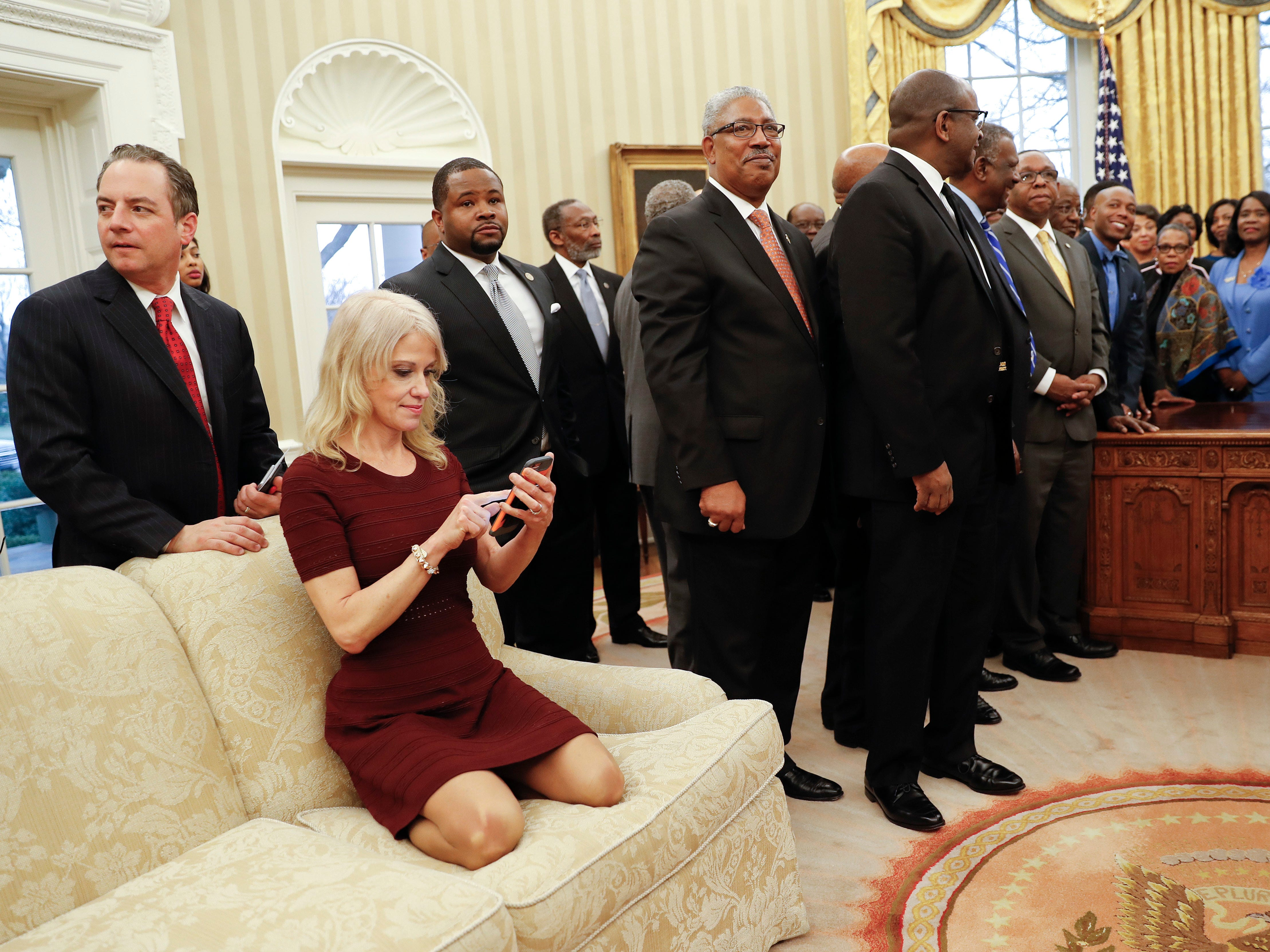 President Donald Trump (right), meets with leaders of Historically Black Colleges and Universities (HBCU) in the Oval Office of the White House. Also at the meeting are White House Chief of Staff Reince Priebus (left), and Counselor to the President Kellyanne Conway, on the couch.