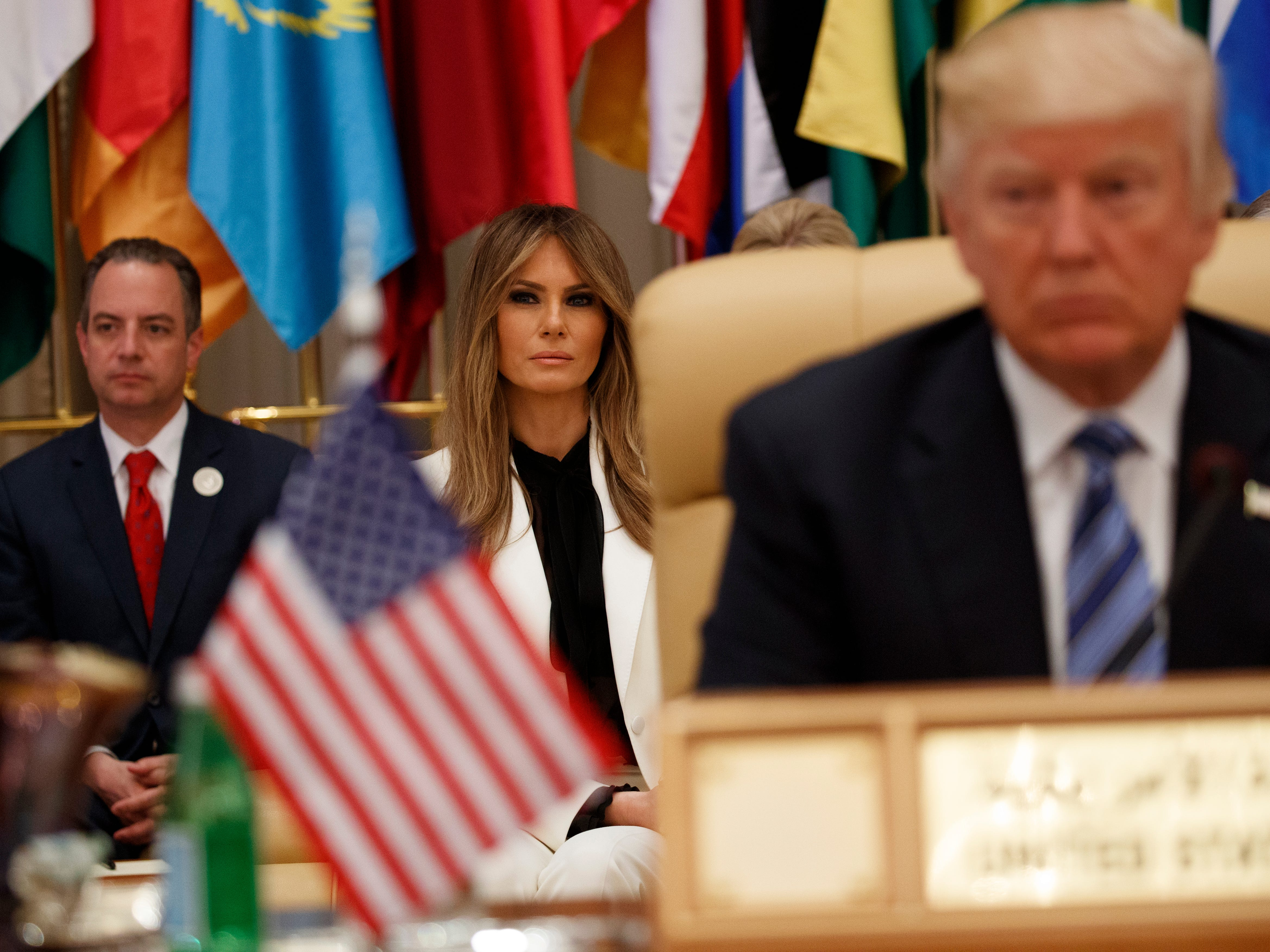 White House chief of staff Reince Priebus (left), and first Lady Melania Trump wait for President Donald Trump to deliver a speech to the Arab Islamic American Summit, at the King Abdulaziz Conference Center in Riyadh, Saudi Arabia.