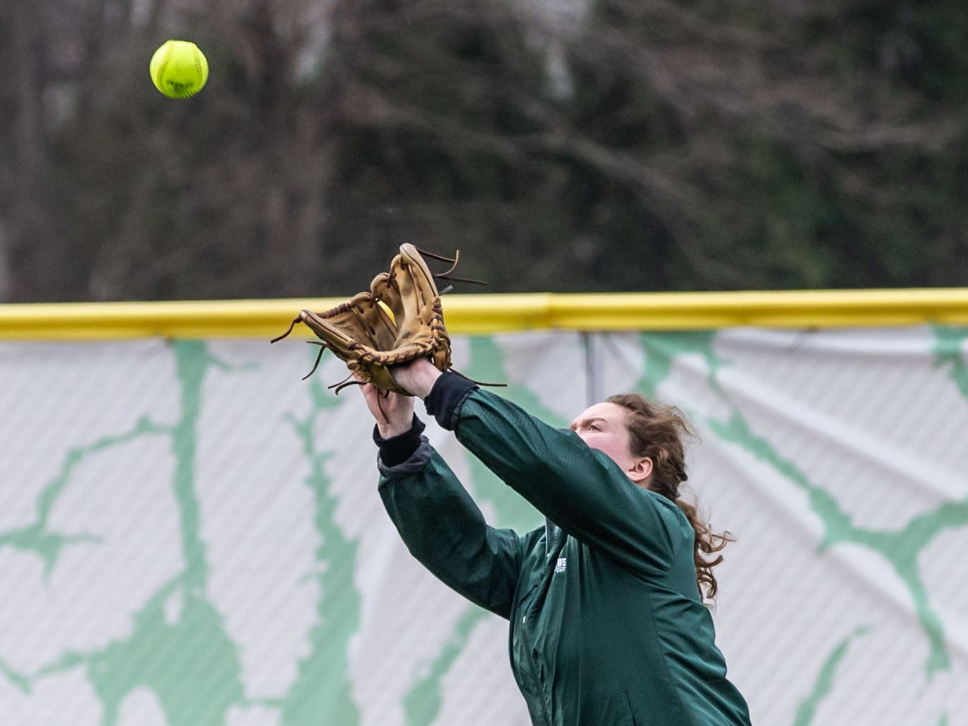 Wauwatosa West right fielder Erin Kirby pulls in a fly ball during the game at home against DSHA on Wednesday, April 17, 2019.