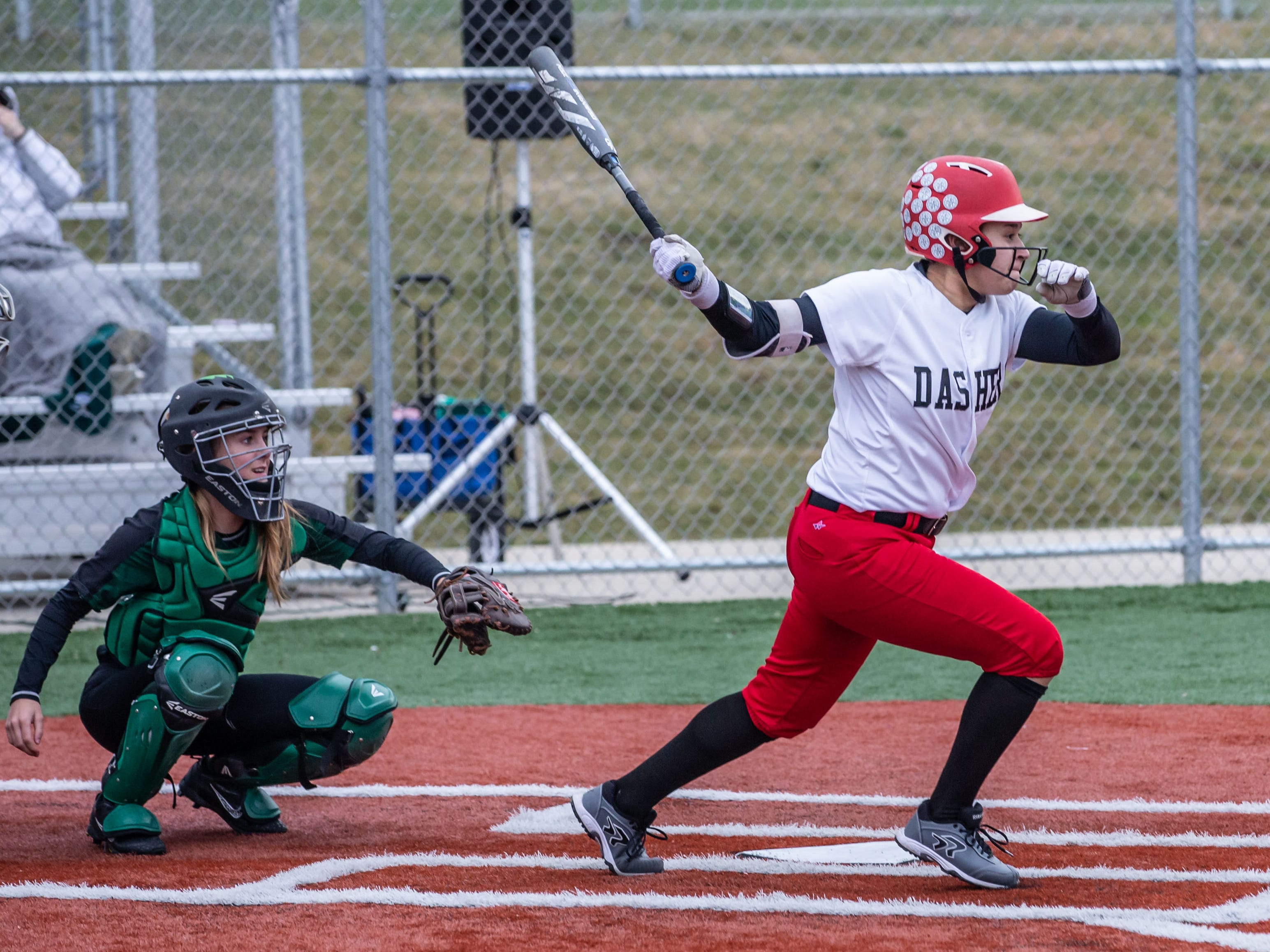 DSHA's Lauren Berridge drives one to center field during the game at Wauwatosa West on Wednesday, April 17, 2019.