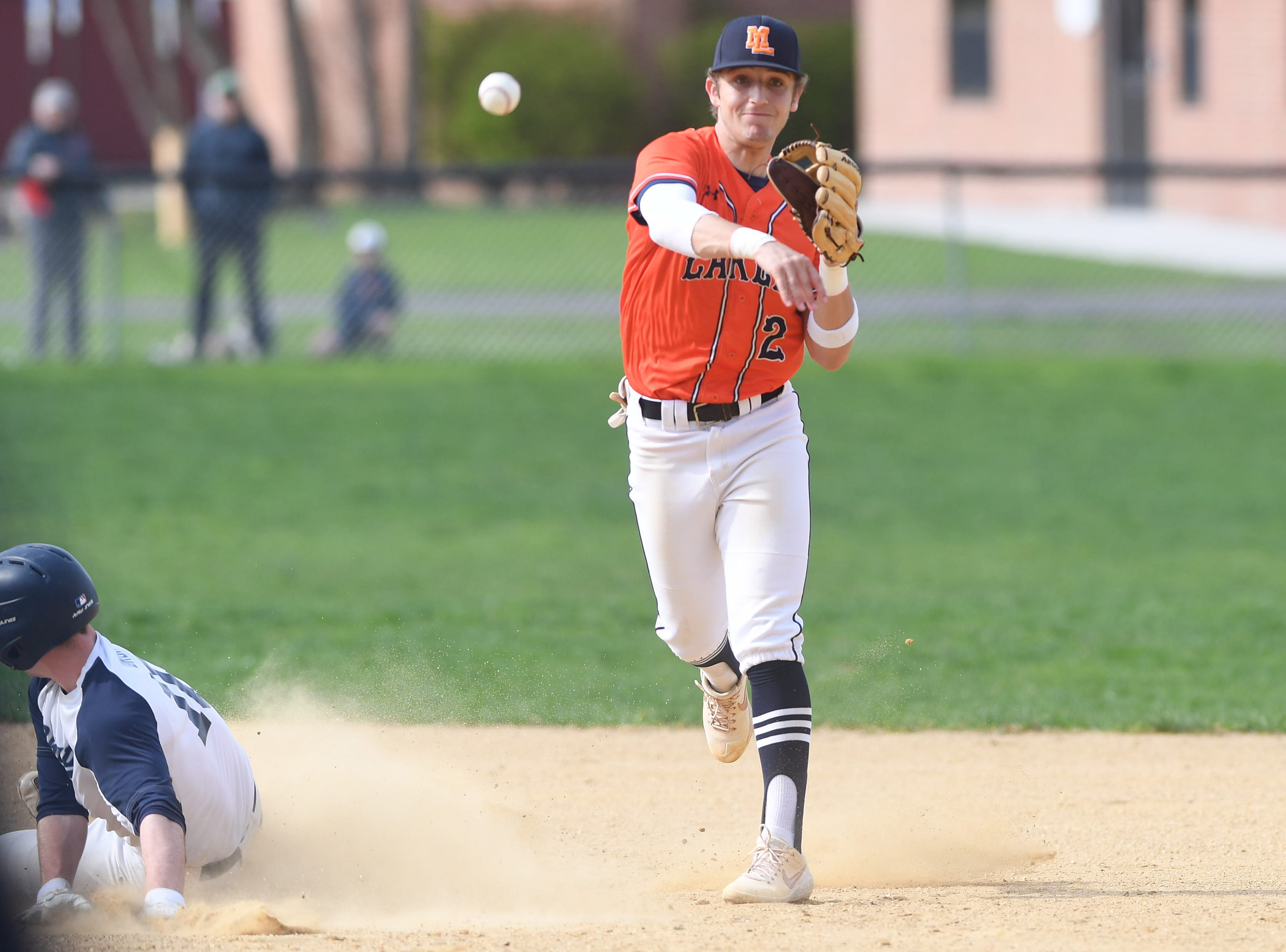 Mountain Lakes baseball at Chatham on Thursday, April 18, 2019. ML #2 Jason Luzzi throws to first after getting the out at second.