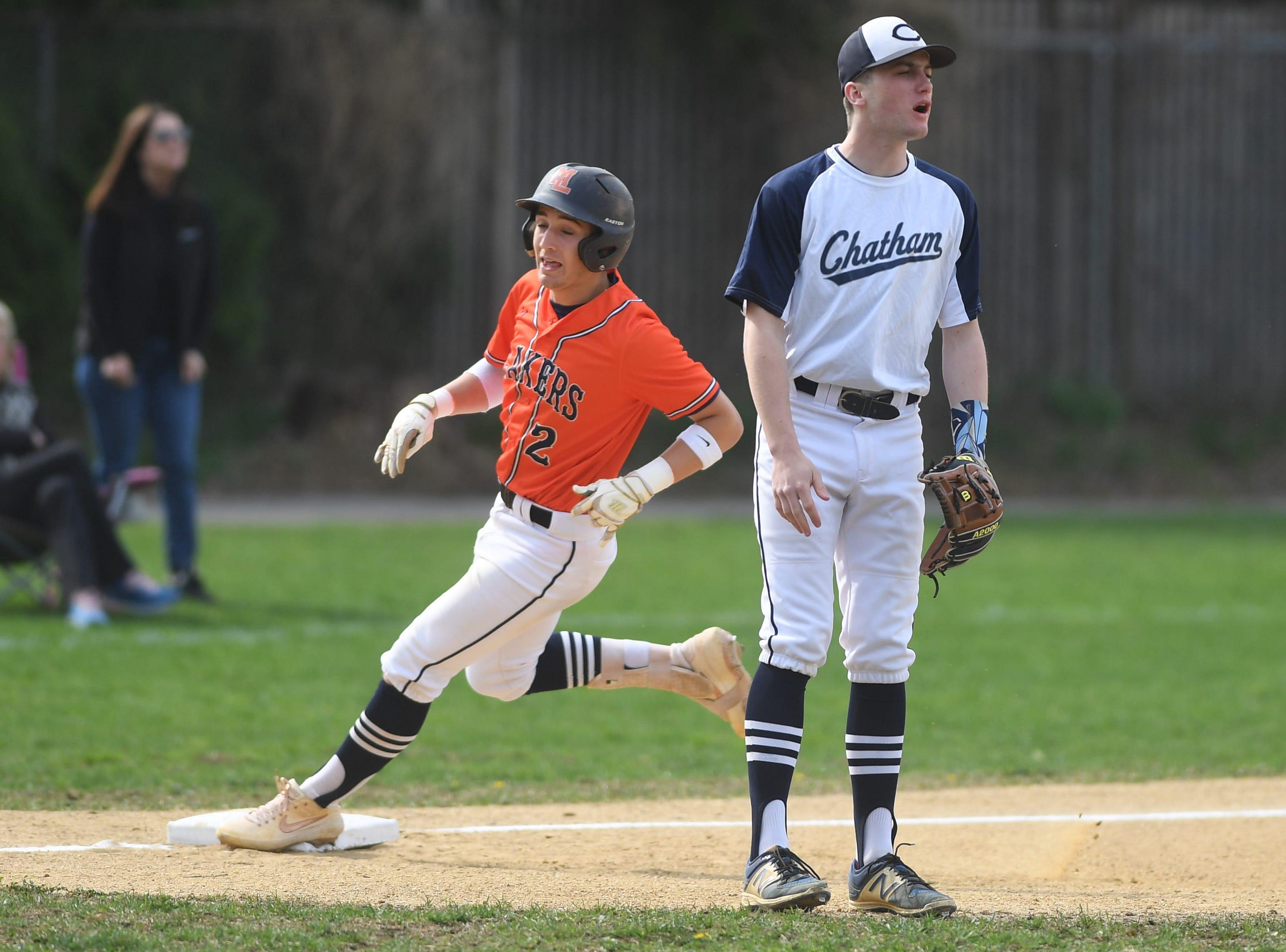 Mountain Lakes baseball at Chatham on Thursday, April 18, 2019. ML #2 Jason Luzzi is safe at third. (right) CM #17 Ben Krill.