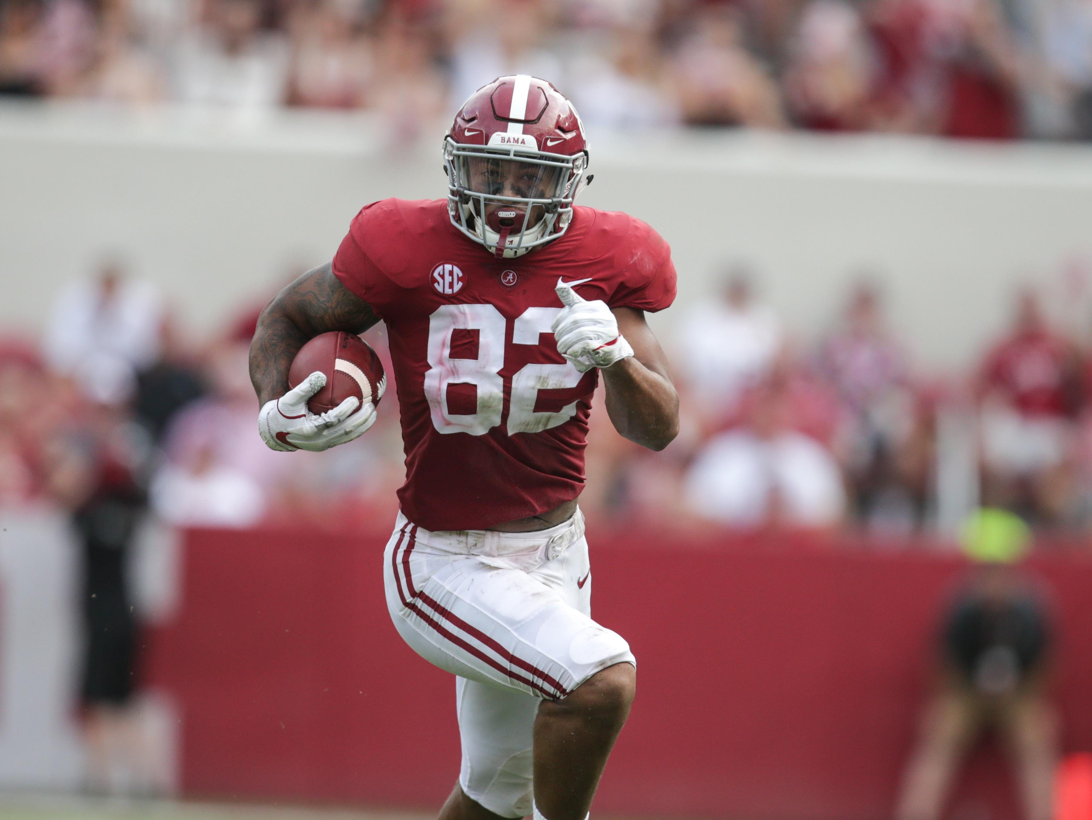 Sep 22, 2018; Tuscaloosa, AL, USA; Alabama Crimson Tide tight end Irv Smith Jr. (82) carries the ball against Texas A&M Aggies at Bryant-Denny Stadium. The Tide defeated the Aggies 45-23. Mandatory Credit: Marvin Gentry-USA TODAY Sports