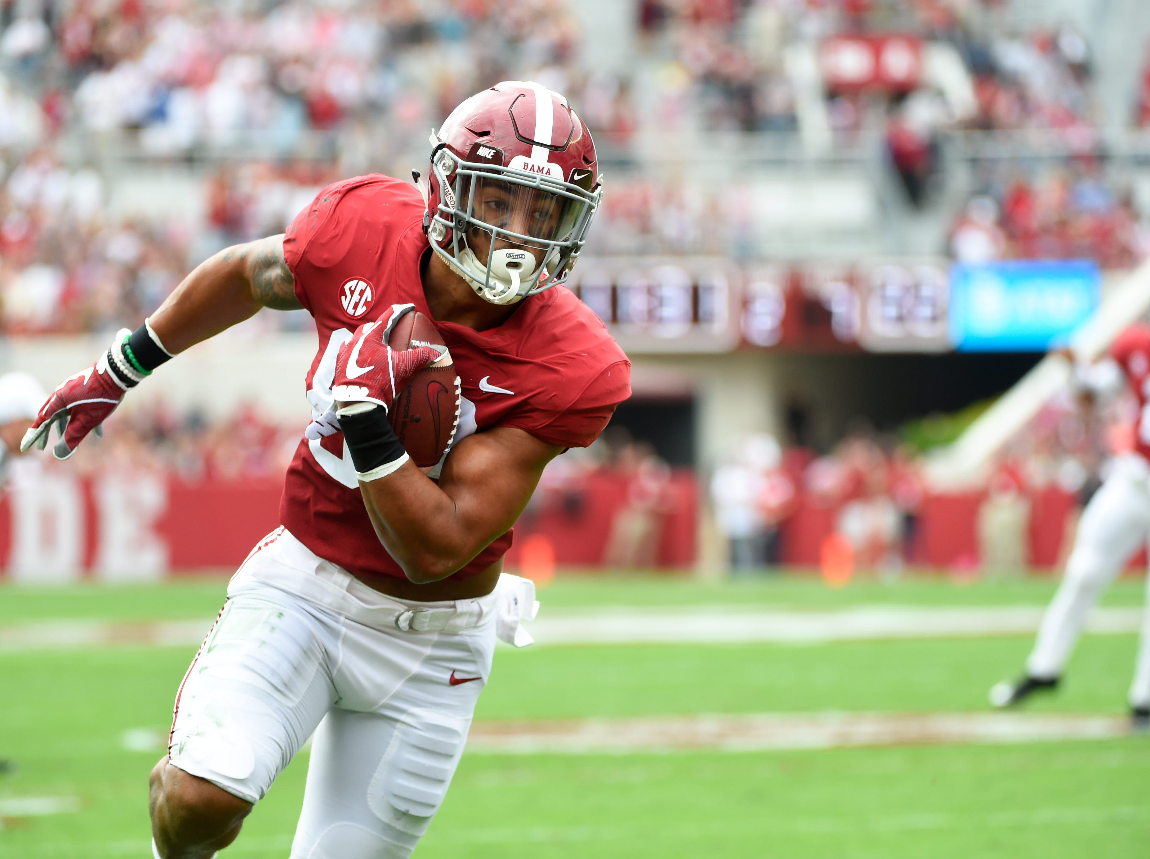Nov 18, 2017; Tuscaloosa, AL, USA; Alabama Crimson Tide tight end Irv Smith Jr. (82) scores a touchdown against the Mercer Bears during the first quarter at Bryant-Denny Stadium. Mandatory Credit: Adam Hagy-USA TODAY Sports