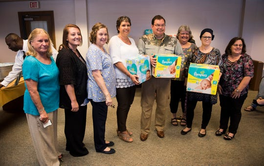 """Reporter Marty Roney hosts a """"baby shower"""" to benefit the River Region Pregnancy Center  in Prattville, Ala., on Wednesday, April 17, 2019."""