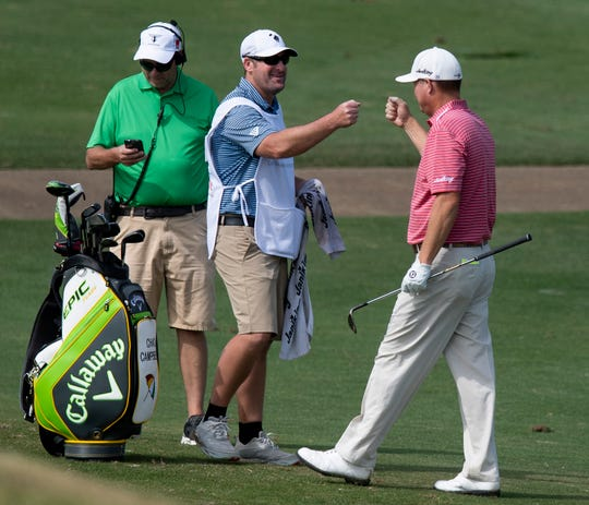 Chad Campbell, right, after putting the ball in on the third hole during the first round of the Web.com Robert Trent Jones Golf Trail Championship in Prattville, Ala., on Thursday April 17, 2019.