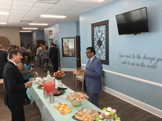 Company officials talk during a grand opening event for Physicians Choice Dialysis in east Montgomery.