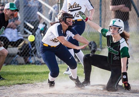 Yorktown's Macie Dowd slides into third base against Delta at Delta High School Wednesday, April 17, 2019.
