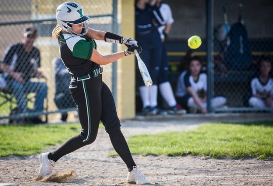 Yorktown's Reagan Cox swings against Delta at Delta High School Wednesday, April 17, 2019.