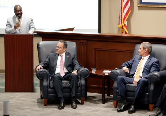 Former inmate Matthew Charles, left, takes part in a discussion on state-level criminal justice reform with Kentucky Gov. Matt Bevin, seated left, and Tennessee Gov. Bill Lee Wednesday, April 17, 2019, in Nashville, Tenn.