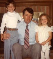 Matthew Paul Turner, left, with his dad, Virgil Turner, and his sister, Elisabeth, on Father's Day morning before the family went to church in 1979.