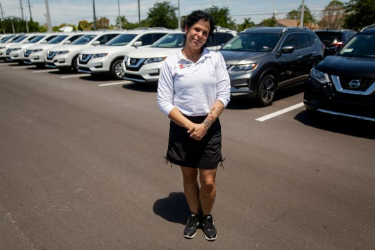 Jesenia Martinez poses for a portrait at Naples Nissan on Wednesday, April 17, 2019. Martinez's years-long drug habit got her kids taken away and caused her to spend seven months in jail. Shortly after her release she decided she wanted to get clean and ended up in a recovery program at St. Matthew's House, which helped her get her kids back and land a job at Naples Nissan where she works as a customer relations manager.