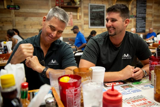 Nick Matson, right, laughs with his dad, Arthur Matson, while they eat breakfast at Nana's Diner in Golden Gate on Tuesday, April 9, 2019. Nick decided to quit drugs after overdosing in early 2017 and went through the Justin's Place Recovery Program at St. Matthew's House. Nick saw the need for a delivery service while working at the thrift stores run by St. Matthew's House in Naples, and he decided to start his own moving company with the help of his father.