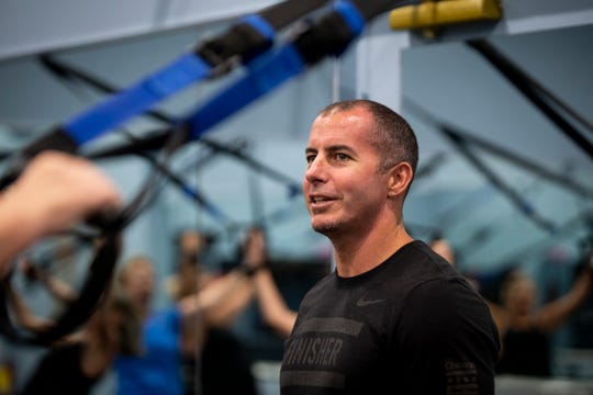 Stan Schoenewald teaches a TRX, or total body resistance exercise, class at Kensington Country Club fitness center in Naples on Monday, April 15, 2019.