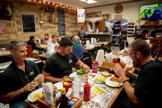 From left to right, Arthur Matson, Nick Matson, and Kenny McAdams eat breakfast at Nana's Diner in Golden Gate on Tuesday, April 9, 2019. The Matsons and McAdams eat breakfast at Nana's every morning before starting work for the day.