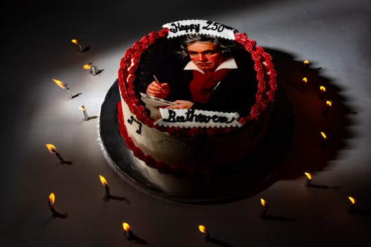 A cake is decorated with the portrait of Ludwig van Beethoven to celebrate his 250th birthday is pictured on Thursday, April 18, 2019 at the Naples Daily News office in North Naples.