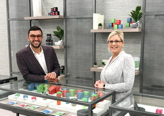 Verdant Creations Managing Partner Corey Poches (left) and Dispensing Manager Tarrisa King opened the medical marijuana dispensary Tuesday on West Church Street.