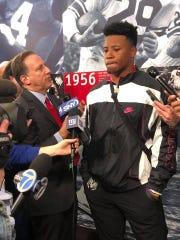 NY Giants running back Saquon Barkley talks to reporters at the team's training facility Thursday.