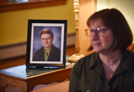 Framed photo of Tyler Clementi who died by suicide after being bullied because he was gay, is seen as his mother Jane Clementi, Co-Founder of the Tyler Clementi Foundation, is seen during an interview about NJ's conversion therapy ban at her home in Ridgewood on 04/18/19.