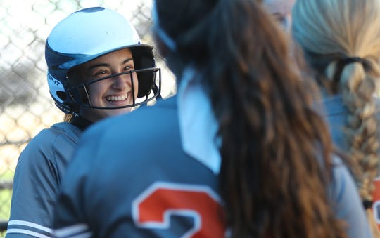 Amanda Gasparino is congratulated by teammates after scoring the only run for Hasbrouck Heights. Thursday, April, 18, 2019