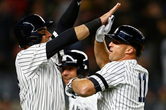 New York Yankees left fielder Brett Gardner (11) celebrates his grand slam home run with Yankees center fielder Mike Tauchman (39) against the Boston Red Sox during the seventh inning at Yankee Stadium.