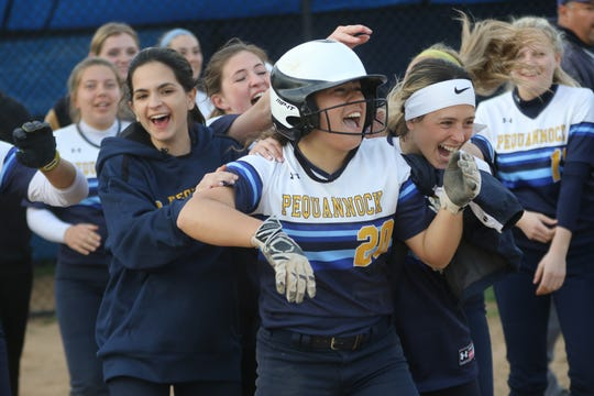 Juliette Davis celebrates with her Pequannock teammates, after scoring in the bottom of the tenth inning against Hasbrouck Heights, for a 2-1 victory. Thursday, April, 18, 2019