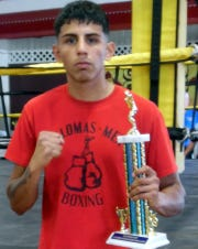 Columbus boxer Jorge Madrid captured the 141-pound Golden Gloves state championship.