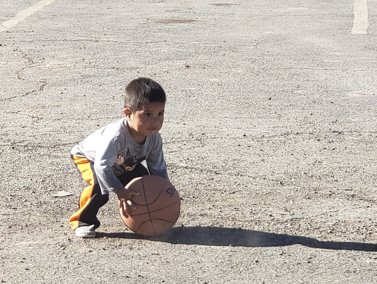 A migrant boy plays at the Gospel Rescue Mission on Thursday, April 18, 2019.