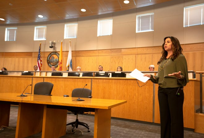 Child Therapist Sueann Kenney-Noziska presents true or false questions regarding child abuse cases to the audience at a town hall Wednesday April 17, 2019, at the Doña Ana County Government Center.