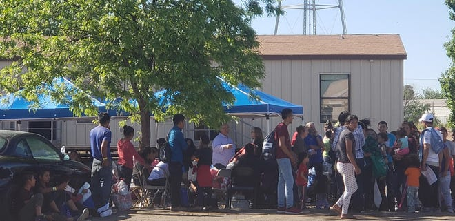 Migrants at the Gospel Rescue Mission await the arrival of New Mexico Homeland Security and Emergency Management Secretary Jackie White on Thursday, April 18, 2019.