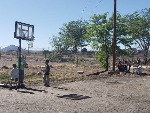 Migrant children play basketball Thursday, April 18, 2019, at the Gospel Rescue Mission.