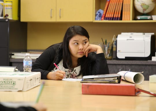 Rhiannon Wagner listens to a lesson by her teacher, Joseph Chee, at Career Prep High School in Shiprock on Thursday.