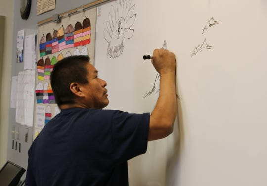Joseph Chee teaches his Navajo culture and language class at Career Prep High School in Shiprock on Thursday.