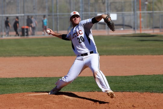 Aztec's Chad Hill throws a pitch against Gallup during Thursday's game at AHS.