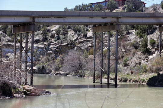 The San Juan River runs under New Mexico Highway 173 in the community of Navajo Dam.