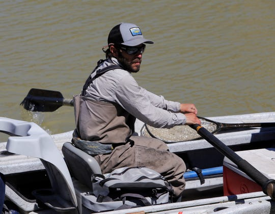 Thom Chacon, a guide with Duranglers, rows a boat out into the San Juan River, Thursday, April 18, 2019, at Texas Hole below Navajo Dam. The dam will begin releasing water for a period, eventually reaching 5,000 cubic feet per second for five days.